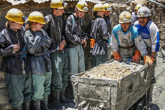 Picture of miners on cart.