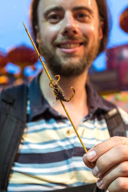 Picture of Dan with scorpion on a stick.