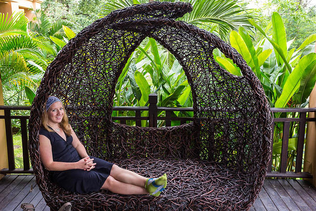 Picture of Katie in a comfortable wicker chair.