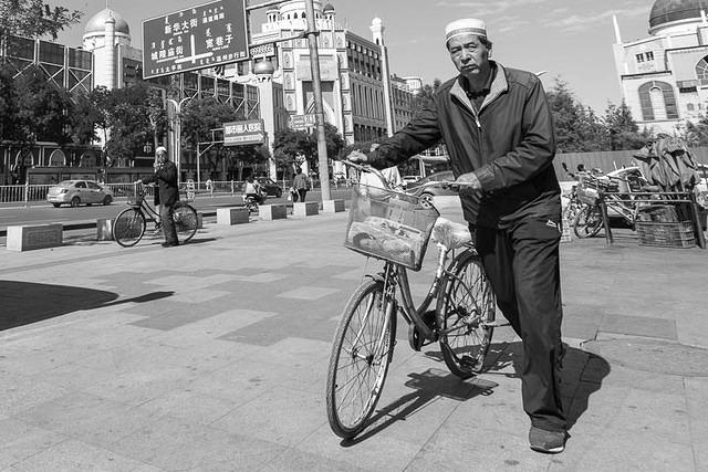 Picture of man with bike.