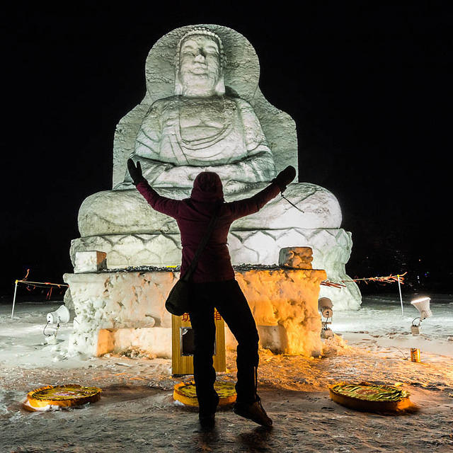 2016: Picture of a snow Buddha with a silhouetted worshiper.