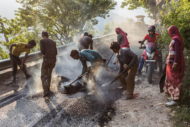 India: Picture of people paving the road from Manali to Vashisht, India.