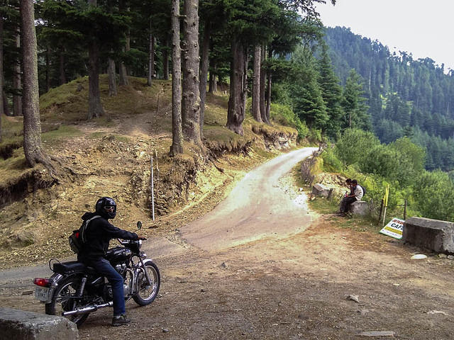 India: Picture of a man on a motorcycle in the forest in India.