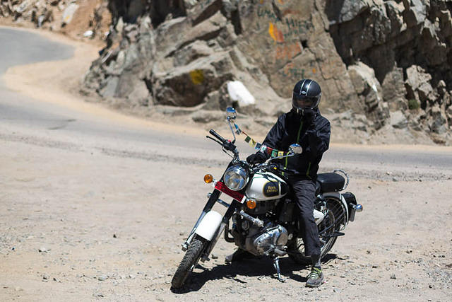 India: Picture of a man on a motorcycle in Leh, Ladakh.