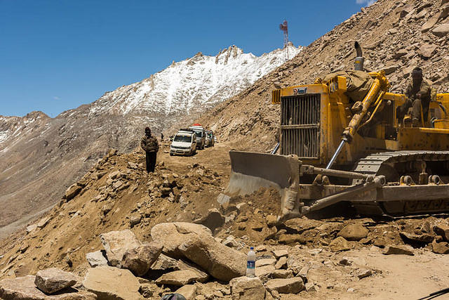 India: Picture of bulldozer on a mountain in India.