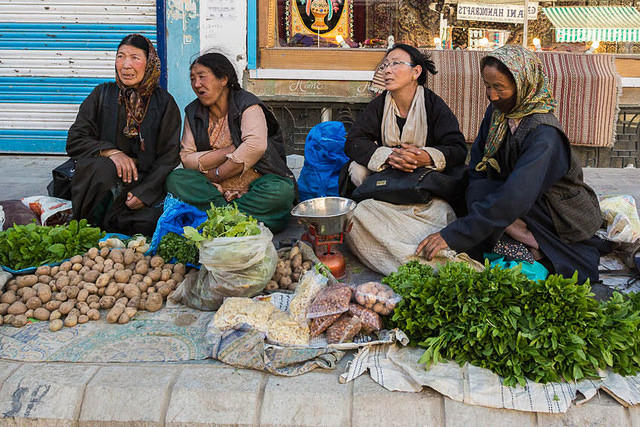 India: Picture of women selling vegetables on the street in Leh, India.