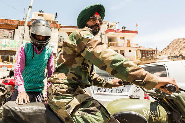 India: Picture of Sikh on a Royal Enfield motorcycle in Leh, India.
