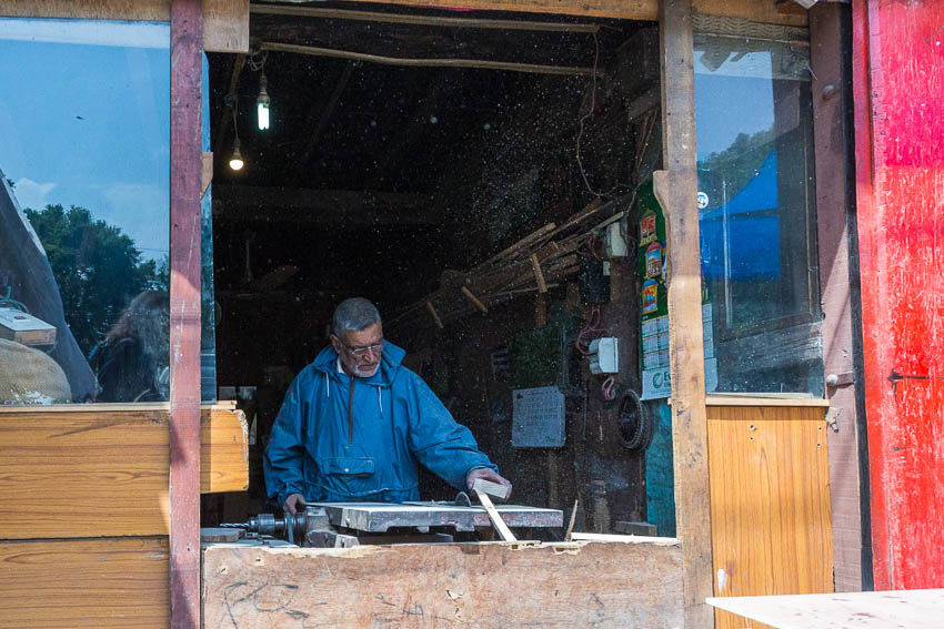 Picture of woodworker in Kashmir.