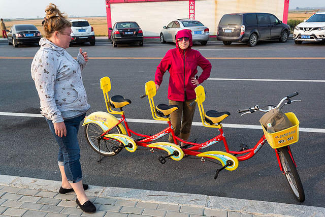 Beijing: Picture of three-person bicycle.