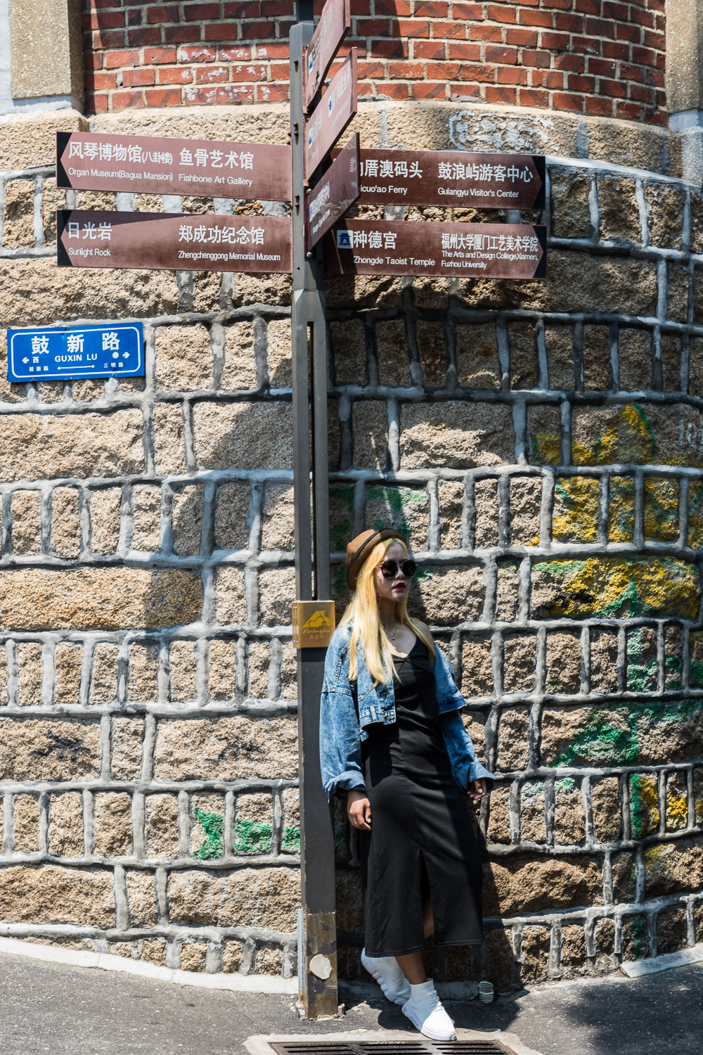 Picture of girl with street sign.