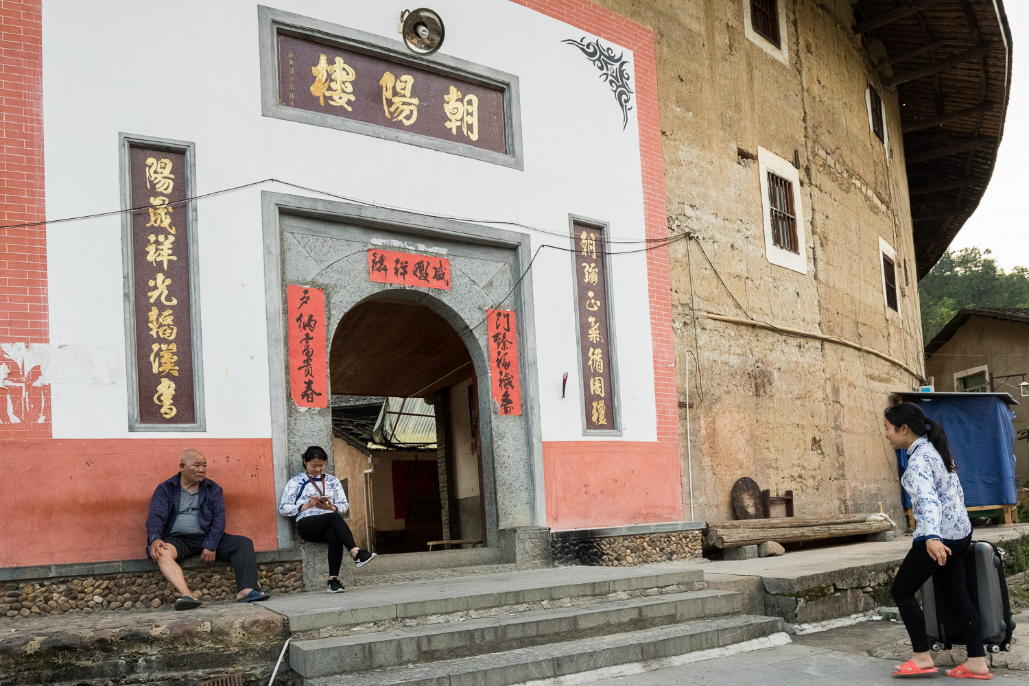 Picture of people outside of tulou.