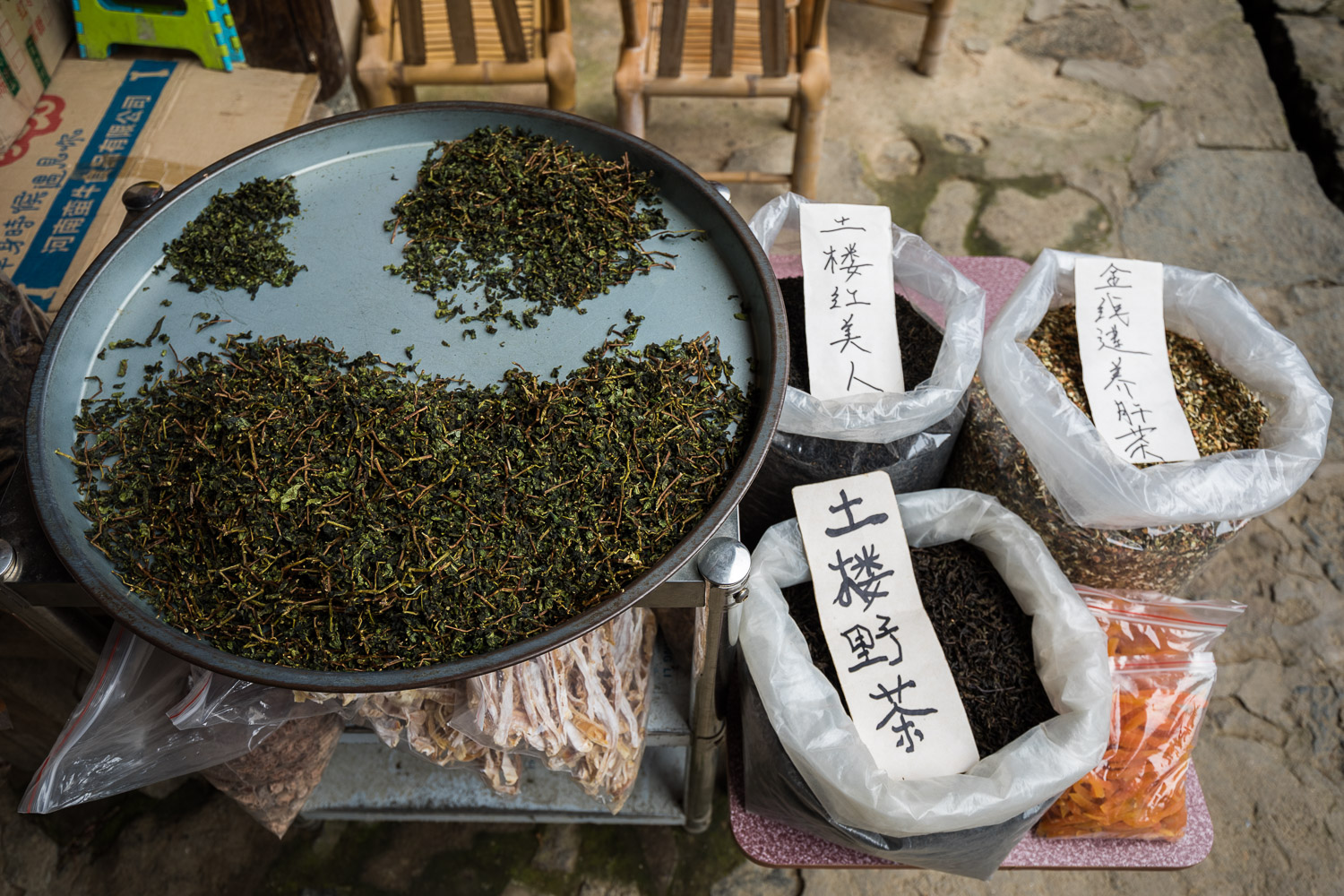 Picture of dried loose tea with Chinese sign.