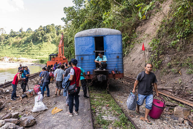 Picture of train next to Sungai Padas River.