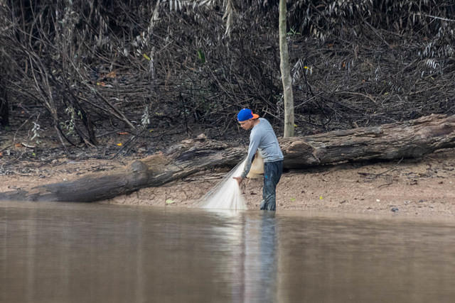 Picture of fisherman with net.