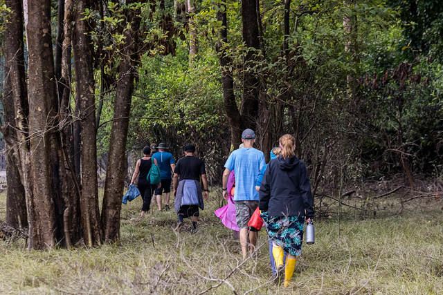 Picture of people walking to the Kinabatangan River.