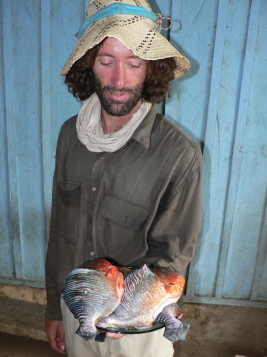 Picture of Craig with piranhas.